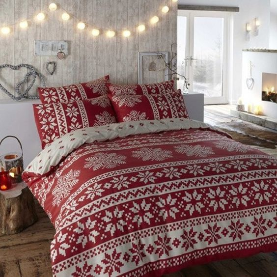 cozy red and white bedding with Scandinavian winter prints