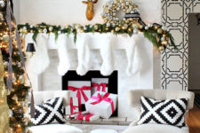 11 evergreen mantel with lights and gold and silver ornaments make a statement