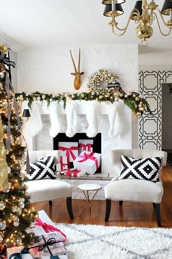evergreen mantel with lights and gold and silver ornaments make a statement