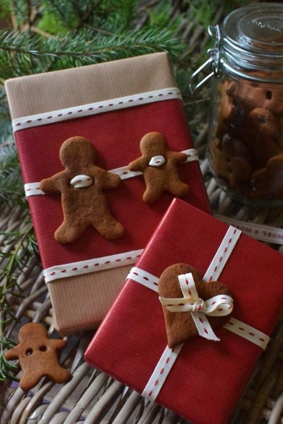 kraft paper, red paper, black and white ribbon and gingerbread cookies