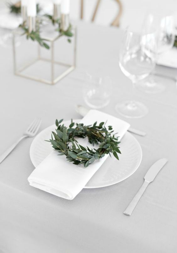 modern white Christmas table with small leafy wreaths