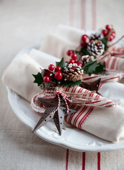 striped napkin rings with a pinecone, faux berries and leaves and a silver star