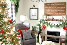 12 Christmas sign, oversized pinecones, an evergreen garland and stockings