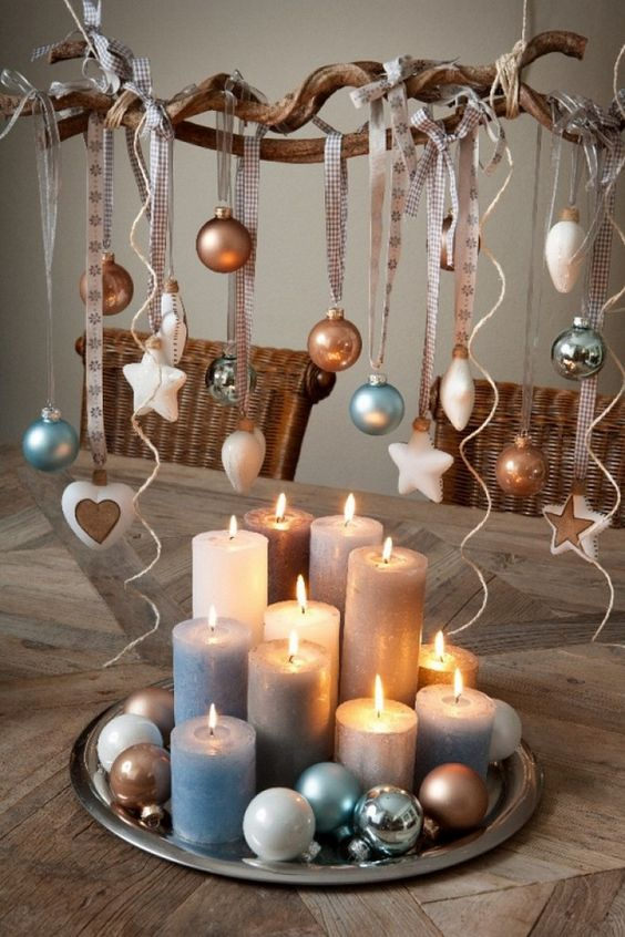 a tray with pillar candles and ornaments