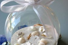 12 beach-inspired ornament filled with sand and small shells