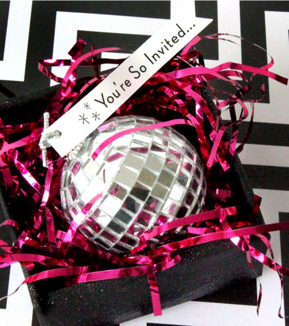 disco balls as invitations to a New Year party
