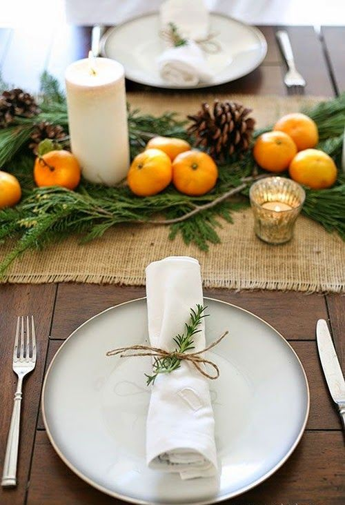 evergreens, pinecones and tangerines on burlap are nice for rustic decor