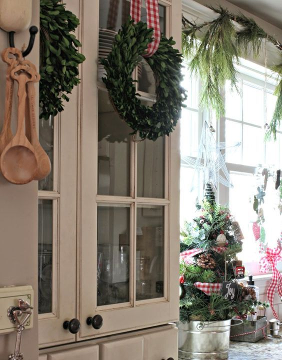 simple boxwood wreaths and a small tree in a bucket will make your kitchen holiday-like