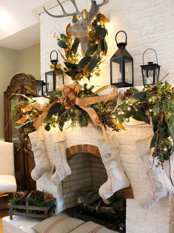 a lush whimsy garland with a large tan bow and industrial stockings