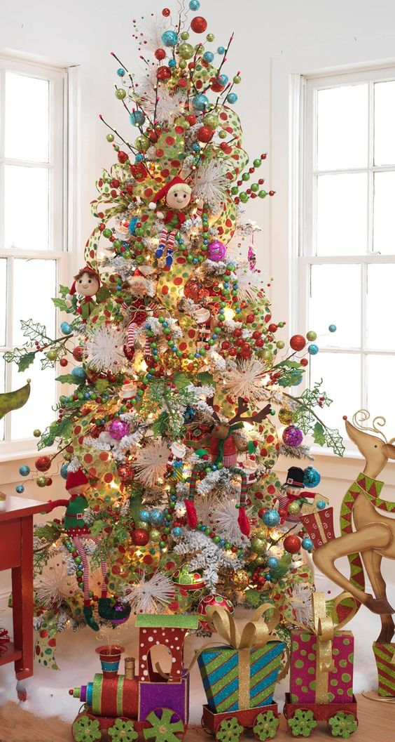 a super bold whimsical tree decorated with toys and ornaments