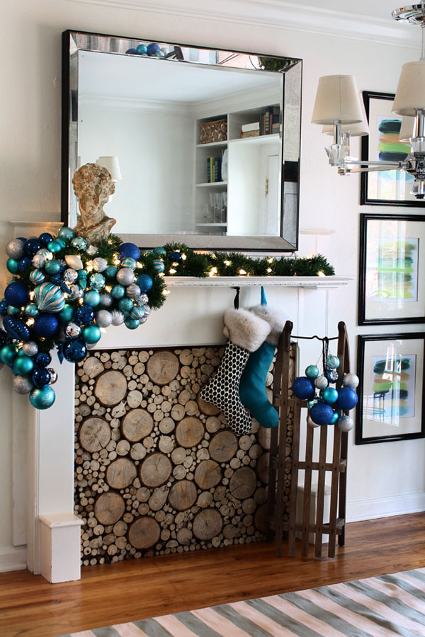 large blue ornament arrangement, lights and faux wood insert