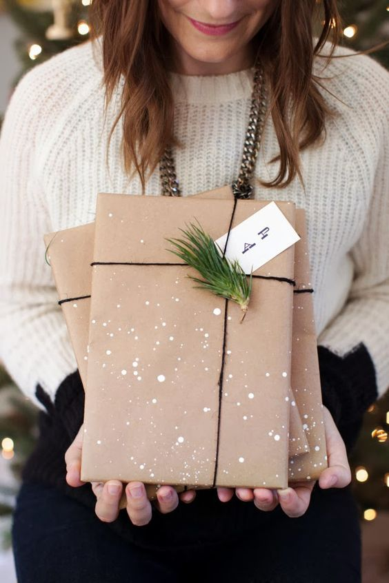 splatter kraft paper with white paint, add black twine and evergreens