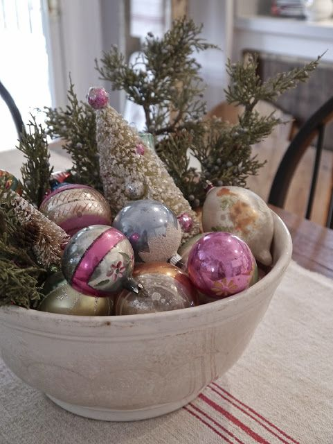a porcelain bowl with retro ornaments and evergreens