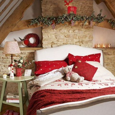 a red blanket and pillows hint on the holidays