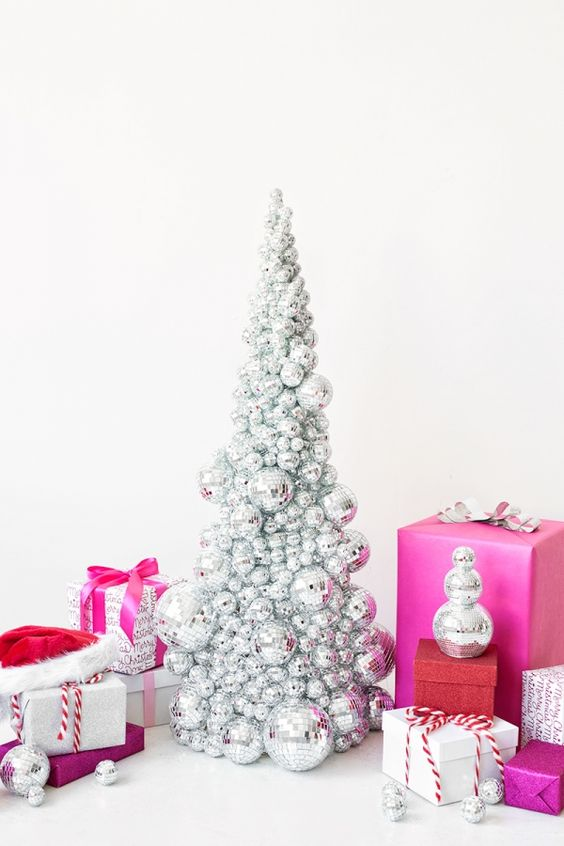 make a small silver disco ball Christmas tree and top the gift with these balls