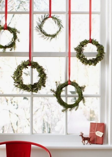 small boxwood wreaths with red ribbon
