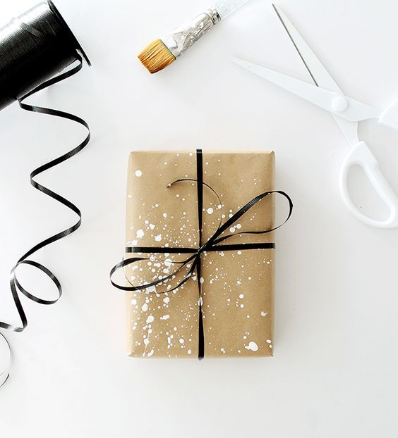 splatter the kraft paper with white paint and add a black bow