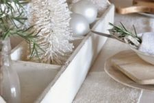 14 white rustic tablescape with a bleached toolbox with small trees and a white fabric table runner