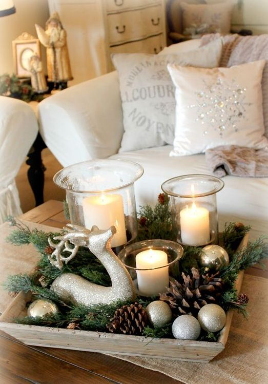 wooden tray with evergreens, pinecones, ornaments and candles