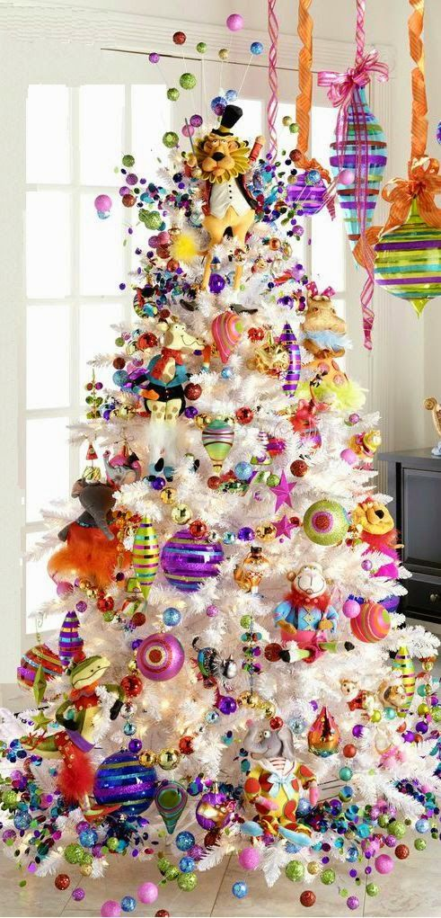 beautiful white tree with colorful ornaments all over - White Christmas Tree Decorations