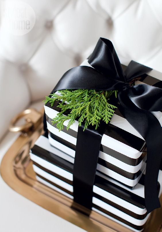 black and white striped paper, black ribbon and fresh greenery