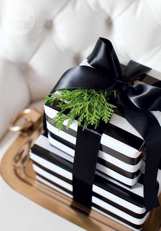 black and white striped paper, black ribbon and fresh greenery