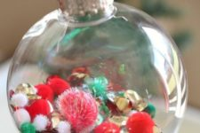 15 colorful pompoms to fill a glass ornament