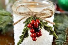 15 decorate candle lanterns with faux holly berries and sprigs