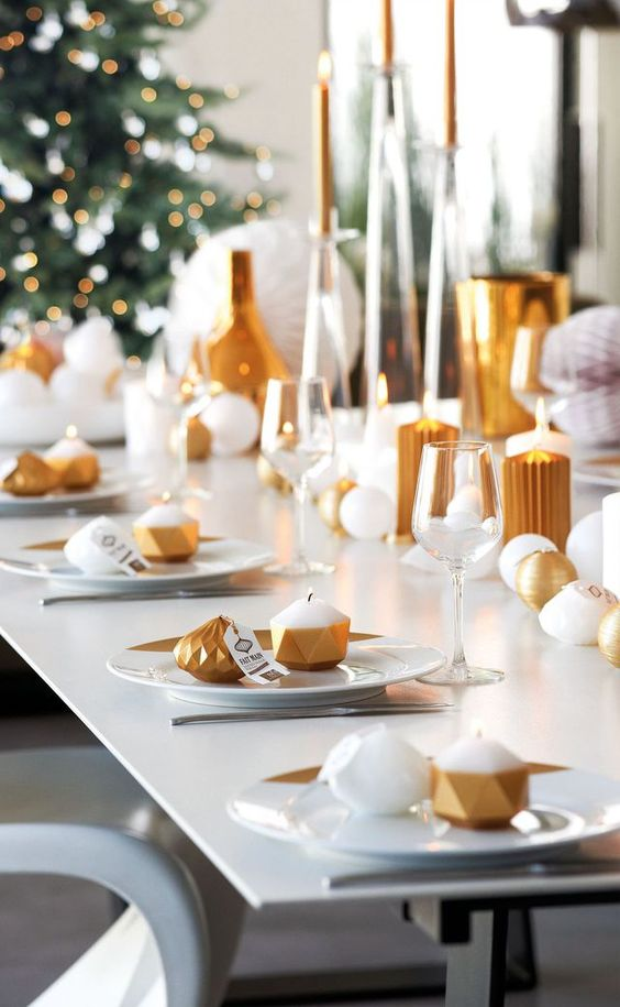 gold and white geometric tablescape wwith lots of candles