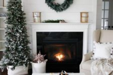 15 modern mantel decorated with a simple wreath and a laconic Christmas tree