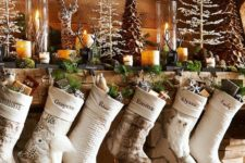 pretty large stockigns with small gift boxes in will ample your mantel festive