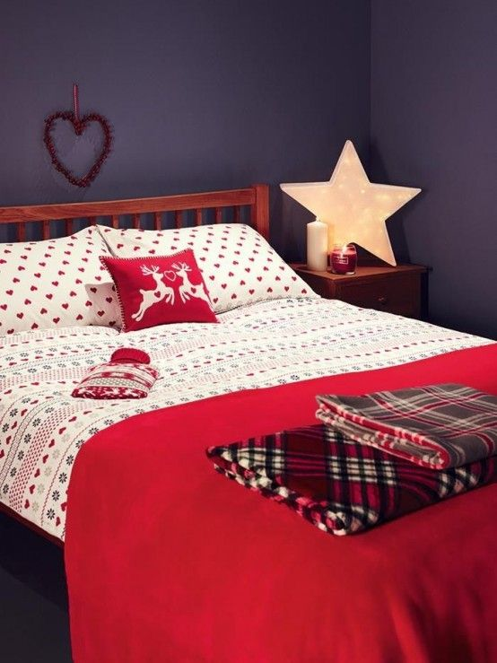 this cozy flannel bedding with a pillow with deer just scream Christmas & 21 Cozy Christmas Bedroom Décor Ideas - Shelterness