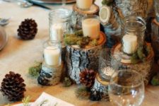 15 wooden logs with candles, moss and pinecones