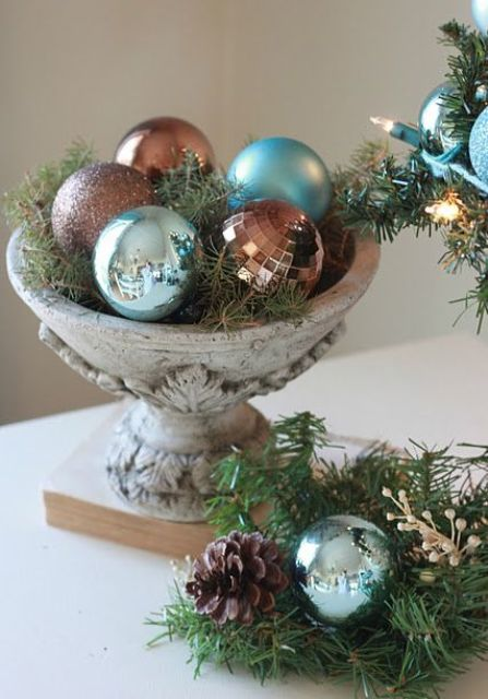 a vintage urn with evergreens and ornaments