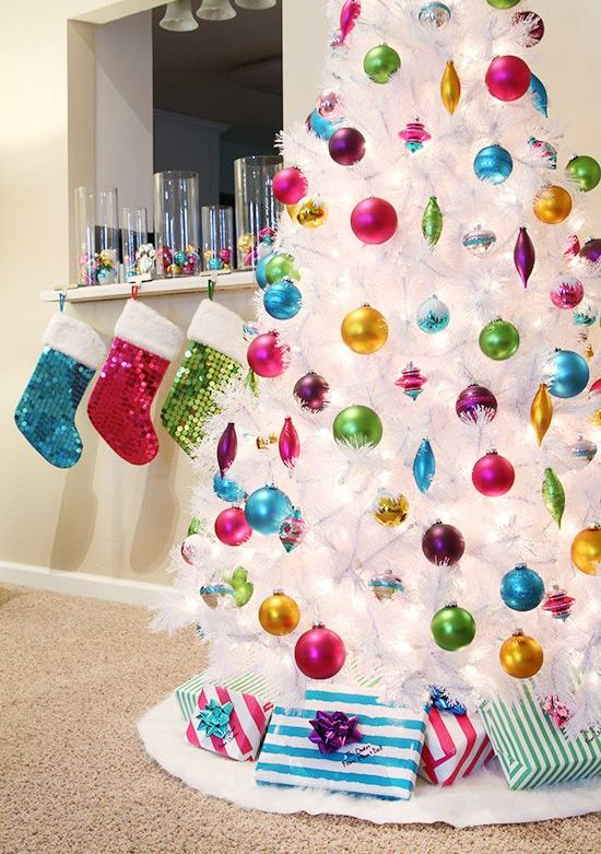 colorful ornaments seem to be floating in the air because of the pure white tree color