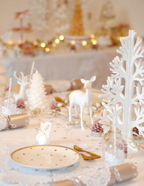 glam table setting with pola dot plates, white trees and deer