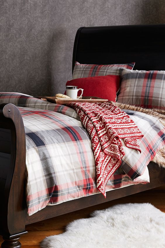 plaid bedding and a cozy Christmas-printed blanket