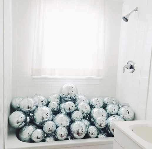 put silver disco balls into your bathtub to excite the guests
