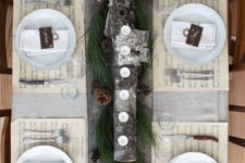 16 wooden plank with logs and candles, evergreens and pinecones as a table runner