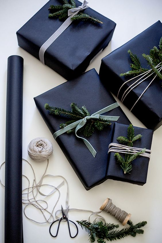 black paper, velvet ribbon and evergreen sprigs