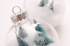 17 faux snow and tiny trees create a Christmas terrarium