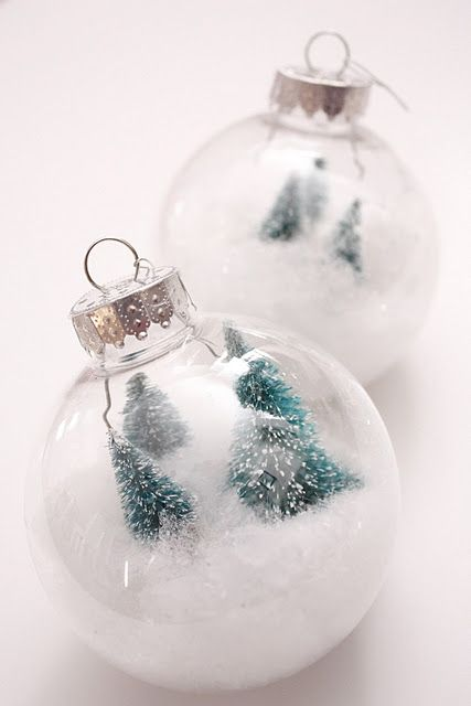 faux snow and tiny trees create a Christmas terrarium