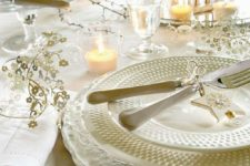 17 ivory Christmas table setting with wooden deer figures, branches and ornaments