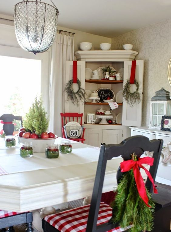 messy wreaths with red ribbon and evergreen chair hangings