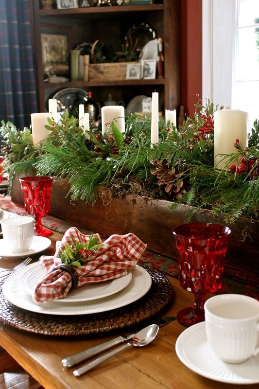 wooden box with greenery, pinecones and pillar candles