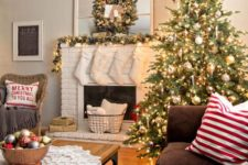 18 a large lit up tree with ornaments and pinecones will easily create a festive mood