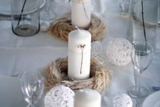 18 pillar candles wrapped with yarn and lace balls for decor