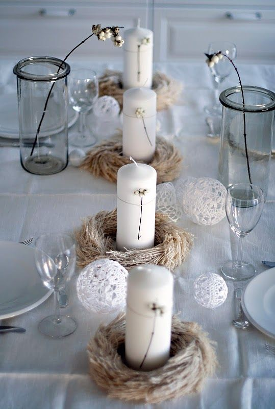 pillar candles wrapped with yarn and lace balls for decor