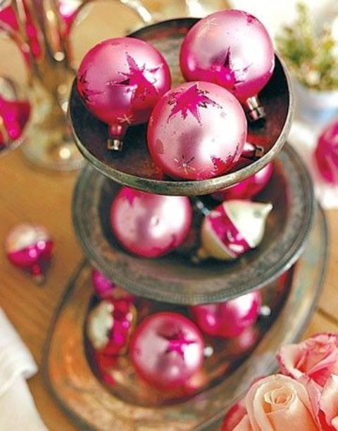pink Christmas ornaments display on an antique cupcake stand
