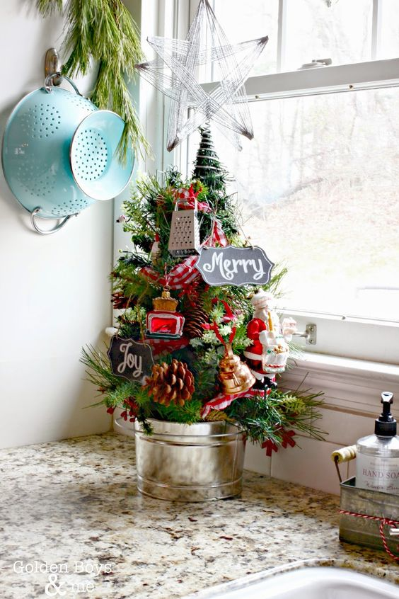 a kitchen Christmas tree decorated with ornaments